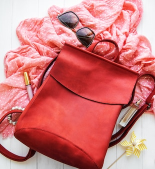 Red leather backpack with  accessories