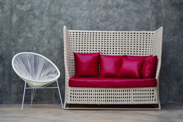 Red leather sofa with pillow