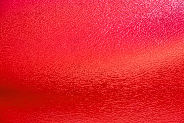 Red leather surface for background. shoes and handbag material