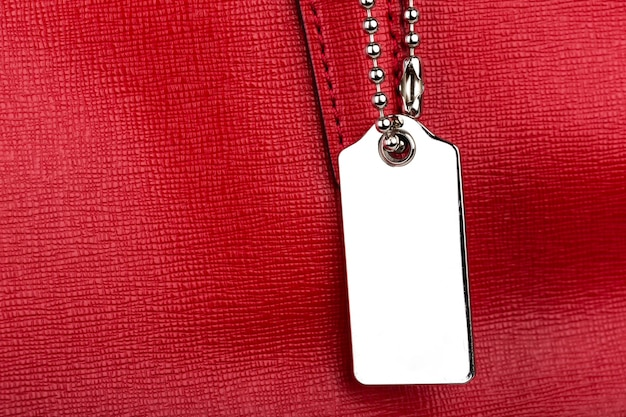 Red leather texture with metal tag