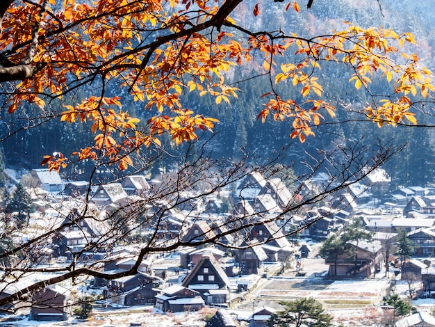 Red leaves and snow in the autumn in shirakawa-go village, japan