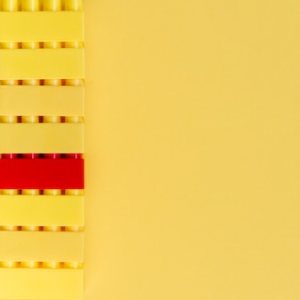 Red lego brick with yellow logo bricks and copy space