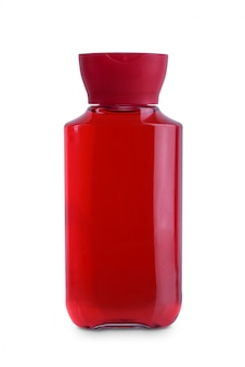 Red lid, transparent body plastic bottle cosmetic hygiene shampoo, conditioner with body moisturising isolated