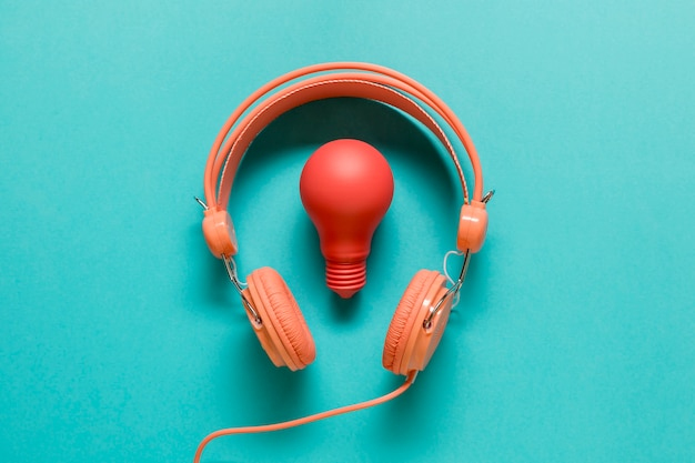 Red light bulb and orange headphones