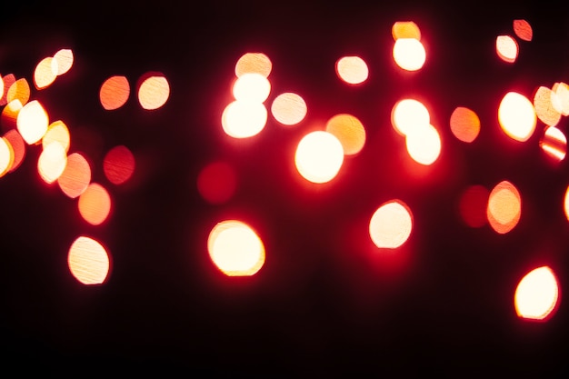 Red lights glowing on dark background
