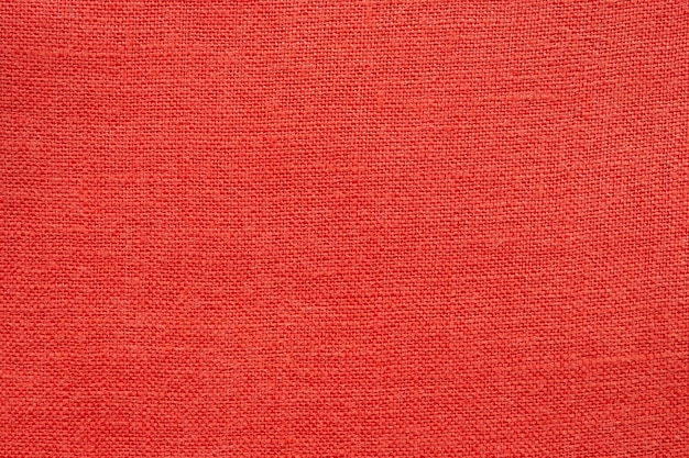 Red linen canvas fabric texture background