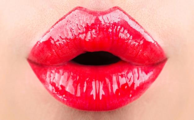 Red lips, beautiful makeup, sensual mouth, sexy lip. red lipstick or lipgloss.