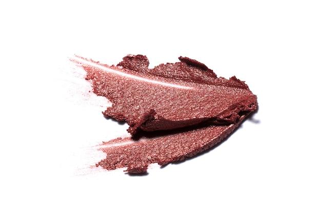 Red lipstick brush stroke isolated on white