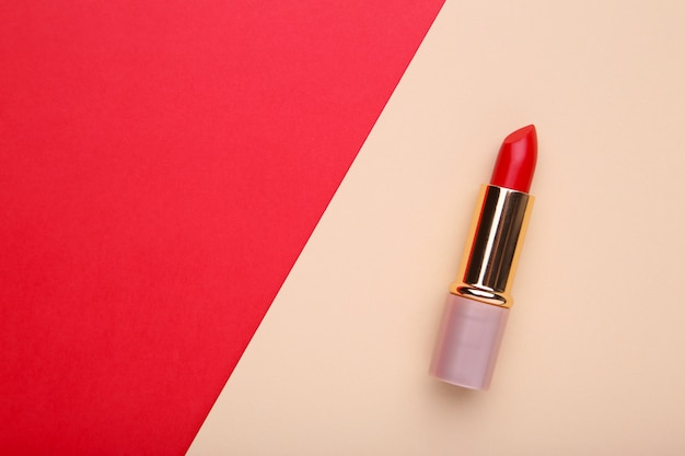 Red lipstick on colorful background, close up