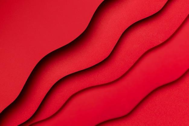 Effetto liquido rosso su strati di carta