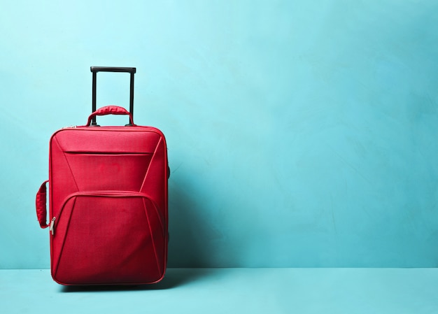 Red luggage with blue blackground