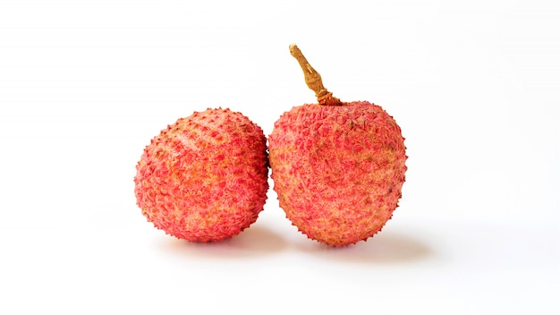 Red lychee fruit on a white background.