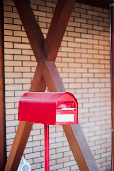 Red mailbox postbox and letter inside