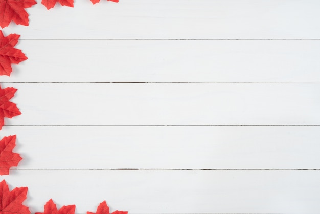 Red maple leaves on white wooden background. autumn, fall concept, top view, copy space.