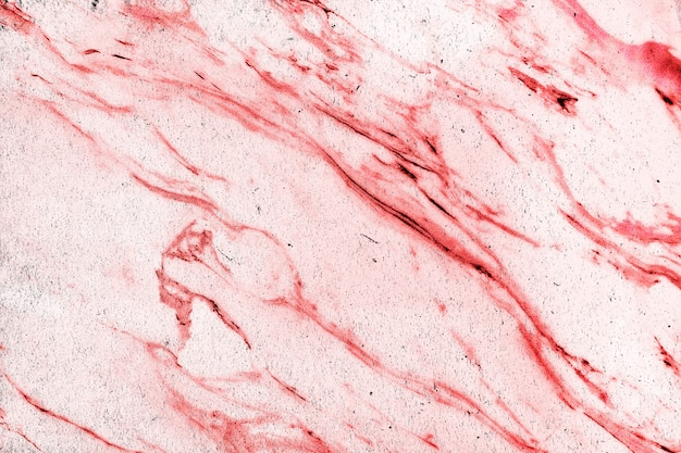 Red marble texture with scratches and cracks with copyspace