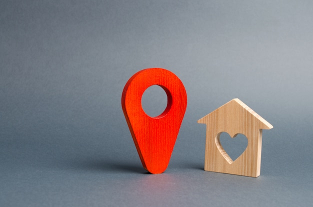 Red marker location and a house of lovers. quiet and cozy, choosing a vacation destination