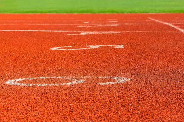Red markings on the racetrack at the stadium.