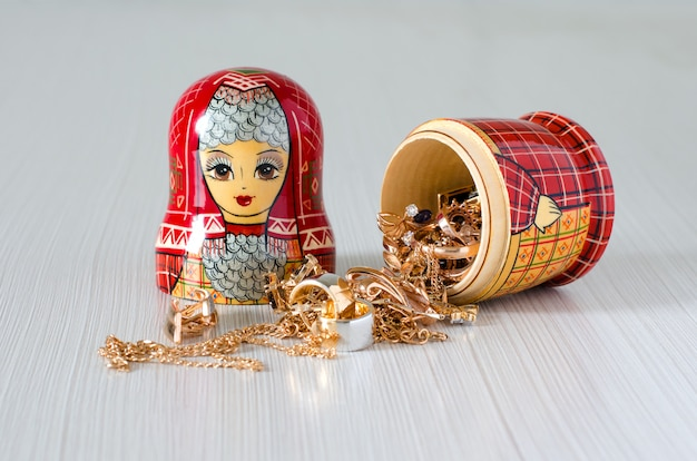 Red matryoshka. gold jewelry in the doll
