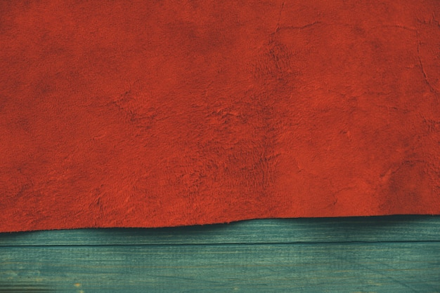 Red matte background of suede fabric. velvet texture of seamless leather. felt material. Premium Photo