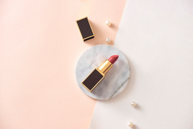 Red matte lipstick on a marble pedestal
