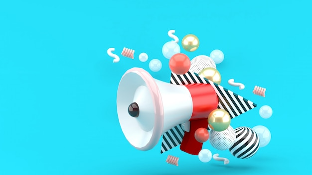Red megaphone among colorful balls on blue. 3d rendering.