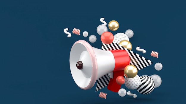 Red megaphone among colorful balls on green. 3d rendering.