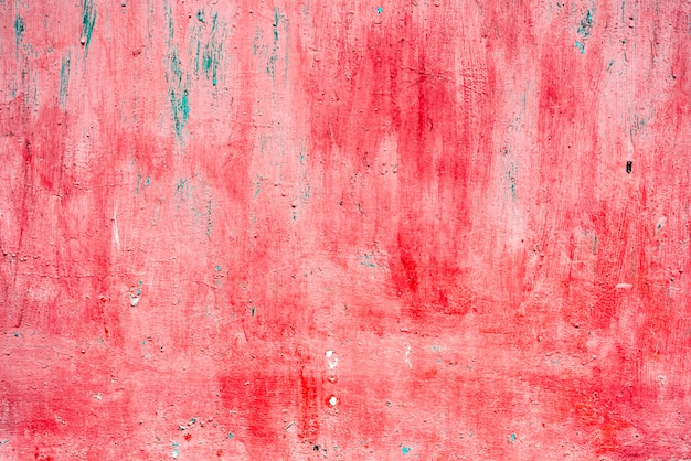 Red metal background painted in red with scratches