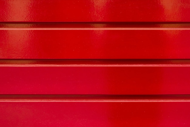 縞模様の赤い金属の背景テクスチャ