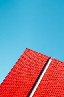 Red metallic wall with sky