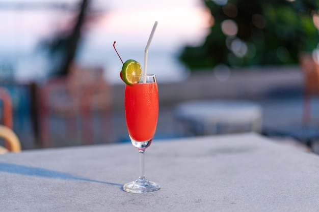 Red mocktail glass at the outdoor place in thailand resort.