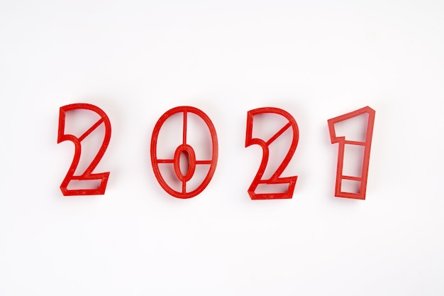 Red mold numbers of 2021 new year isolated on white background.