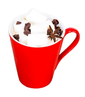 Red mug with hot chocolate with melted marshmallow on white background
