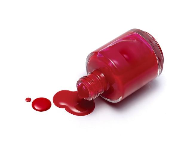Red nail polish bottle isolated on white