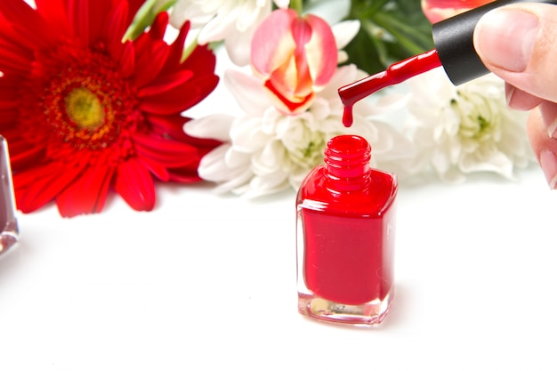 Red nail polish with flower