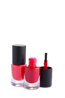 Red nail polishes bottle isolated on white background