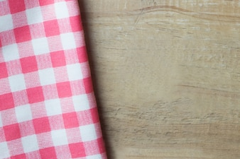 Red napkin on wooden table top angle view