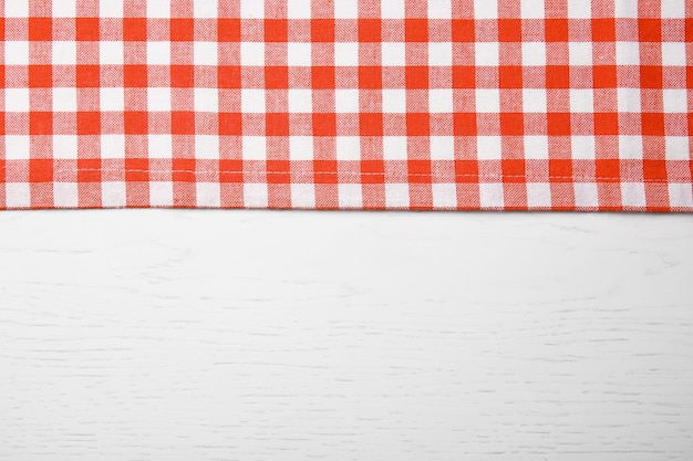 Red napkin on wooden table