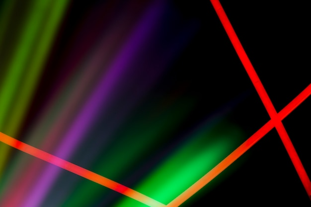 Red neon lines over the colorful laser light on dark background