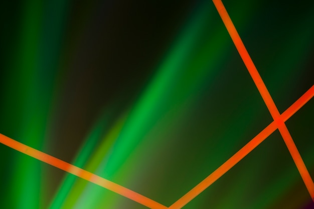Red neon lines on green illuminated dark background