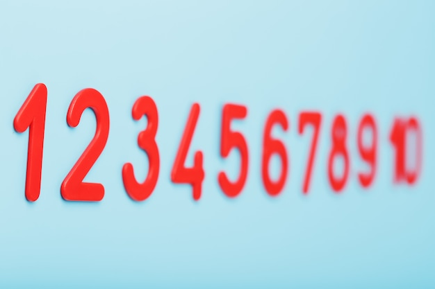 Red numbers on a blue background in a row from one to ten.