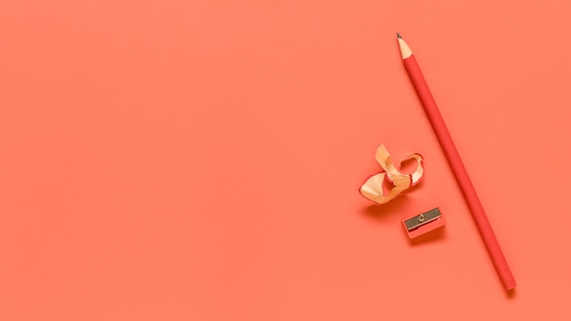 Red office supplies on colored surface