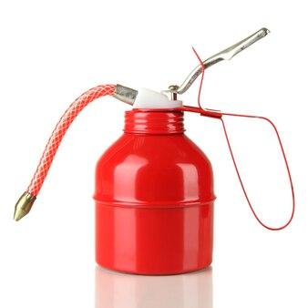 赤のオイル缶、白で隔離