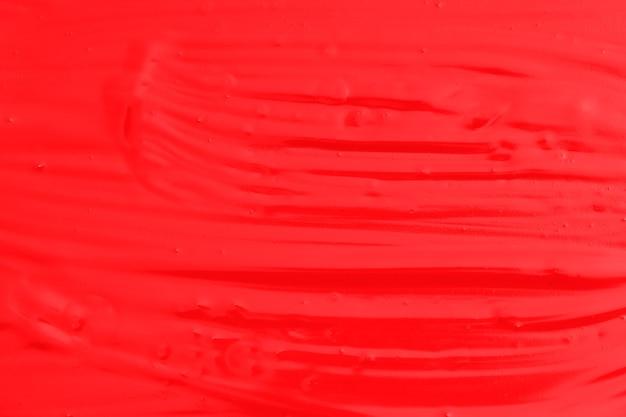 Red oil paint. background for designer