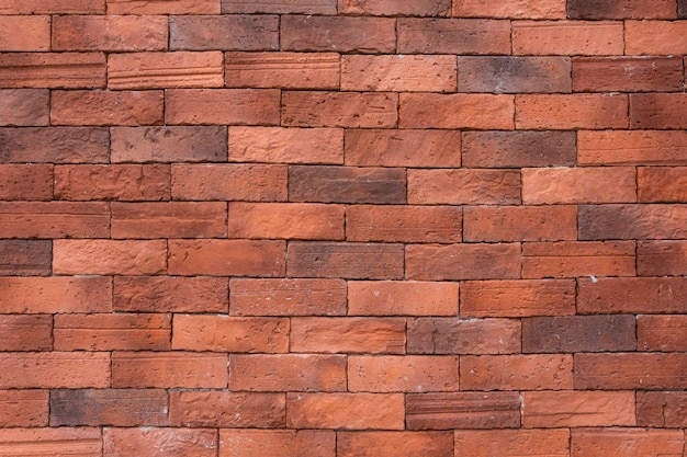 Red old brick wall background.