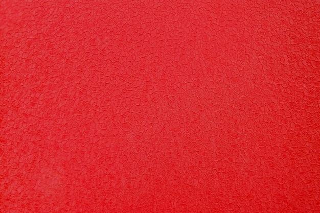 赤い古いセメントの壁のコンクリートの背景のテクスチャ。