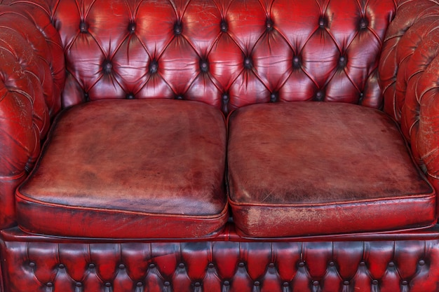 Red old vintage genuine leather sofa texture background