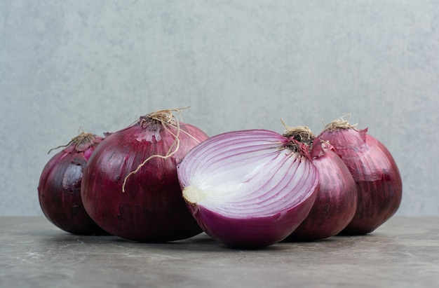Red onion bulbs on marble background. high quality photo