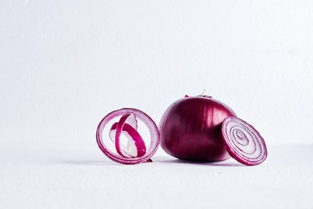 Red onion on a white table.