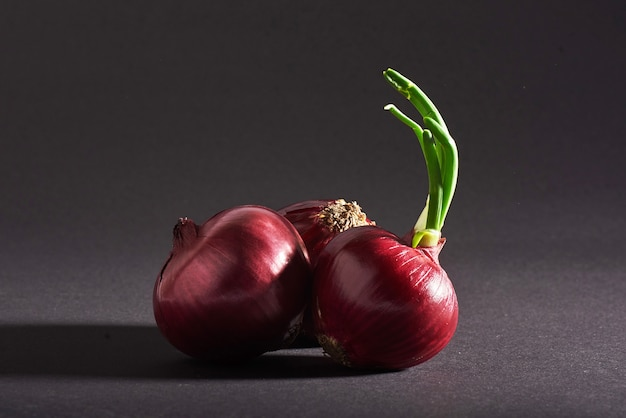 Red onions whole, isolated on a black