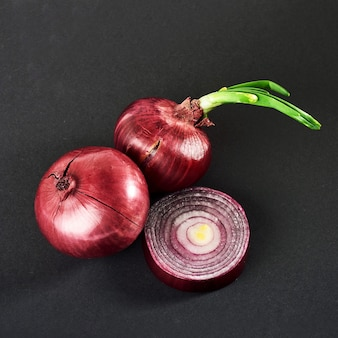 Red onions whole, isolated on a black.
